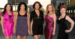 "Jacquelina Laurita, from left, Teresa Giuidice, Danielle Staub, Dina Manzo and Caroline Manzo strut down the Atlantic City Boardwalk in ""The Real Housewives of New Jersey.""/Credit Bravo"