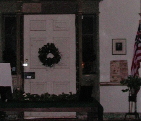 This close-up of the above photo appears to show a transparent figure directly to the right of the door.