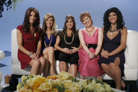 "Teresa, far right, revealed that the purple (amethyst?) necklace she wore above at the reunion actually belongs to Caroline, who bought it at Neiman Marcus. ""Teresa is a jewelry whore,"" Caroline added./Credit Bravo"